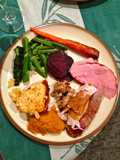 Christmas dinner at my sister and brother-in-law's - green beans, roasted carrots, beets, ham, turkey, stuffing, sweet potato casserole and mac 'n cheese.